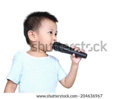 Happy Kid singing, with black microphone, isolated on white background - stock photo