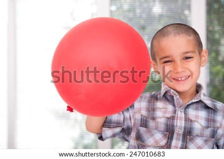 Happy kid with balloons - stock photo