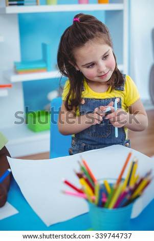 Happy kids enjoying arts and crafts together in the bedroom - stock photo
