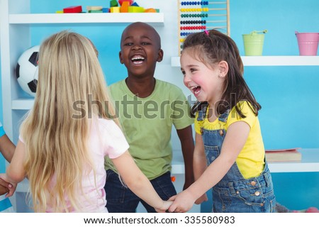 Happy kids holding hands together in the bedroom - stock photo
