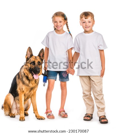 happy kids in white t-shirts with shepherd dog isolated - stock photo