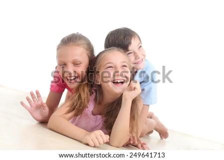 happy kids lying on the floor  - stock photo