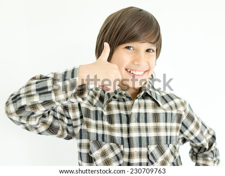 Happy kids posing with thumb up - stock photo