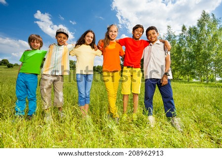 Happy kids standing in a row straight - stock photo