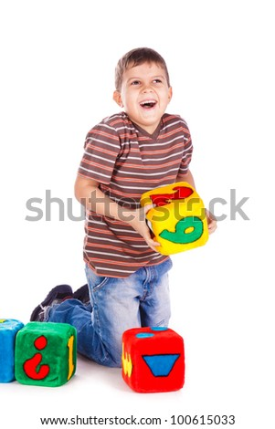 Happy kids throughing block with numbers over white background - stock photo