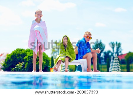 happy kids warm up in towels after swimming - stock photo