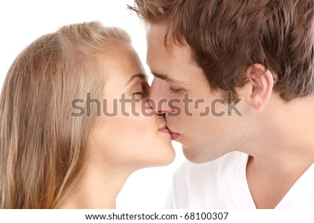 Happy kissing couple in love. Over white background - stock photo