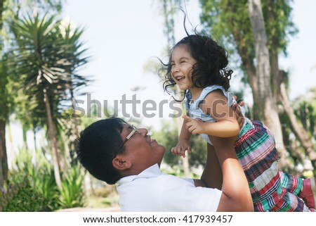 Happy latin father and daughter - stock photo