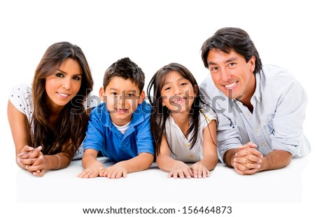 Happy Latinamerican family lying on the floor - isolated over white  - stock photo
