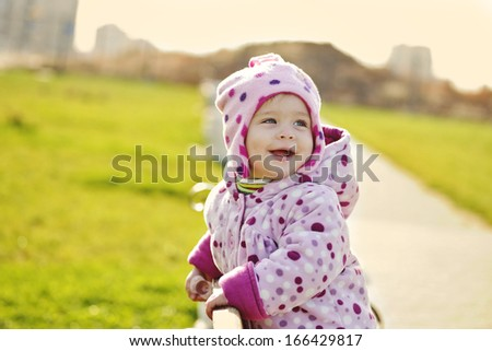 happy laughing baby  in the park - stock photo