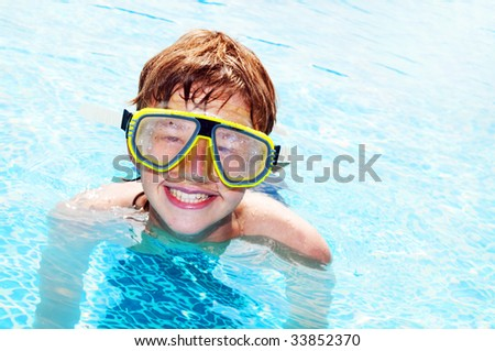 Happy laughing boy in a pool - stock photo