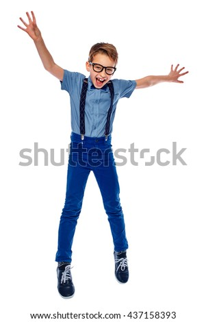 Happy laughing boy in glasses jumping up. He is smiling and screaming something. Isolated on a white background. Full - length. - stock photo