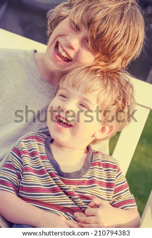 Happy laughing brothers. Instagram effect - stock photo