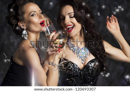 Happy Laughing Women Drinking Champagne and Singing Xmas Song - stock photo