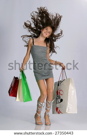 Happy laughing young with color bags - stock photo