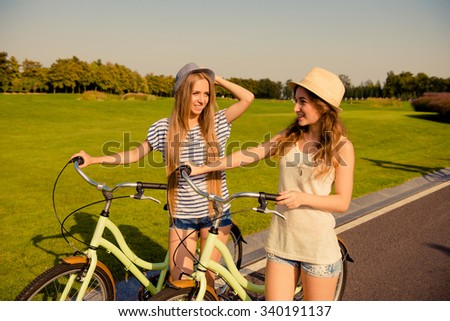 happy lesbian couple together to ride a bicycle - stock photo