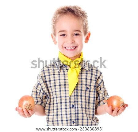 Happy little agriculturist boy holding ripe onions - stock photo