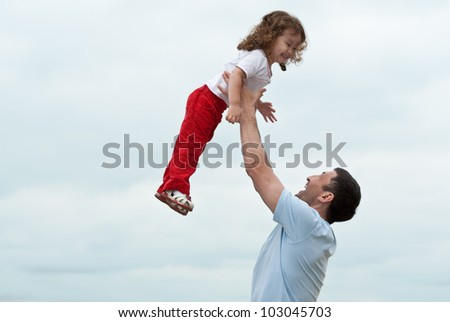 Happy little asian girl enjoying time with her daddy - stock photo