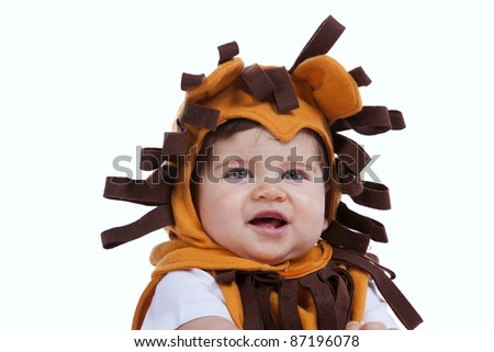 Happy little baby boy with a funny lion mask (isolated on white) - stock photo