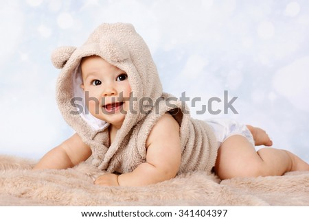 Happy little baby crawling in diaper - stock photo