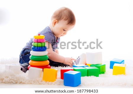 happy little baby playing with colorful cubes. development of the child. age of 7 months. isolated  - stock photo