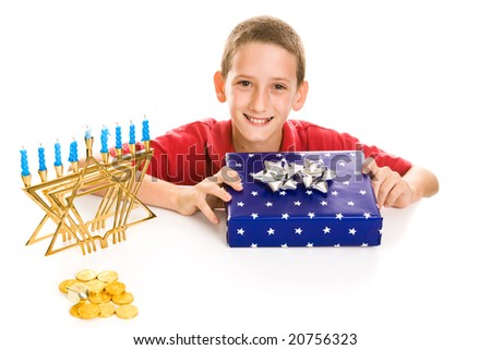 Happy little boy excited about opening his hanukkah gift.  Isolated on white. - stock photo
