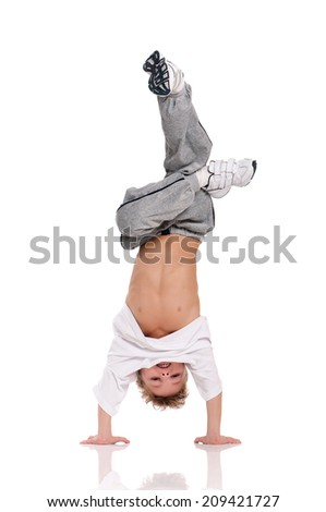 Happy little boy gymnastic acrobatics equilibrium posture isolated on white background - stock photo