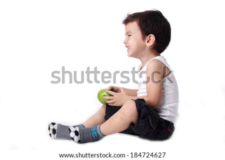 Happy Little boy holding apple isolated on white background - stock photo