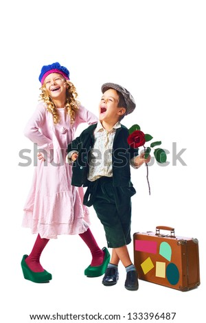 happy little boy keep rose in hand and happy girl in green shoes with suitcase on white background - stock photo