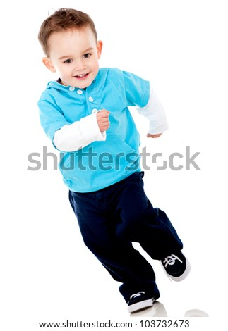 Happy little boy running - isolated over a white background - stock photo