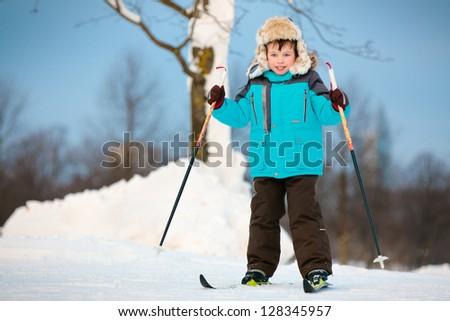 Happy little boy skiing on cross - stock photo