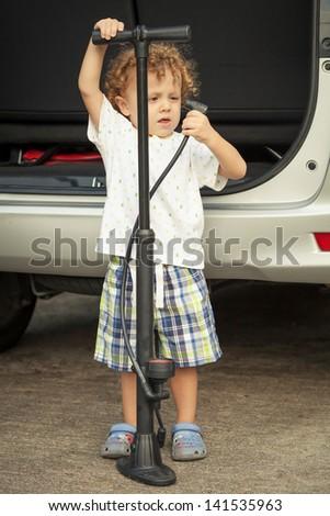happy little  boy standing near the car - stock photo