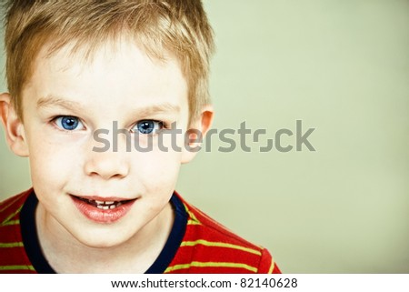 Happy little boy with blue eyes - stock photo