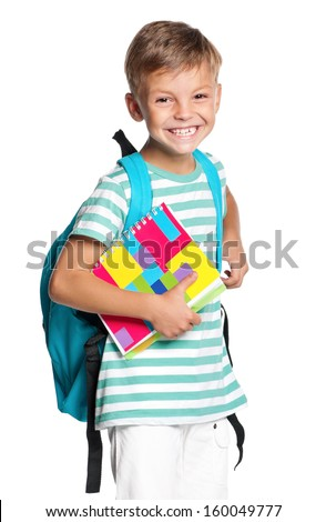 Happy little boy with exercise book isolated on white background - stock photo