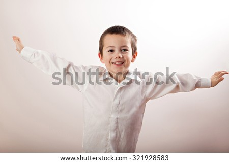 Happy little boy with his hands in the direction of - stock photo