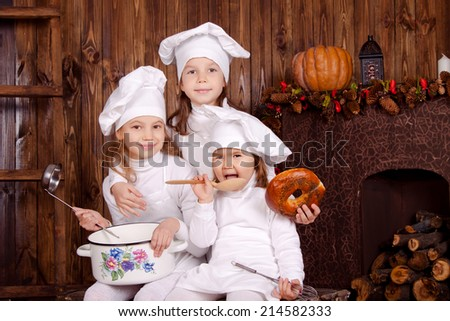 Happy little chef. Children cook - stock photo