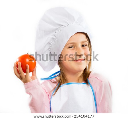 Happy little chef holding a tomato - stock photo
