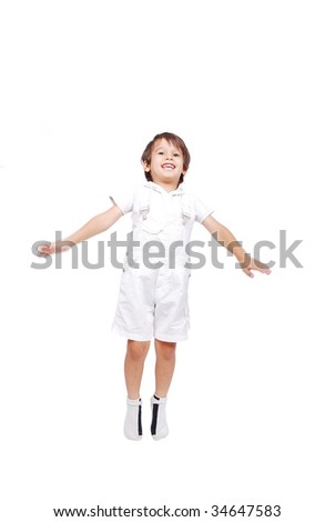 Happy little child in white clothes is jumping isolated - stock photo