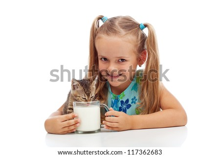 Happy little girl and her kitten sharing a cup of milk - isolated - stock photo