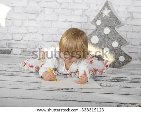 Happy Little girl at Christmas. Studio concept - stock photo