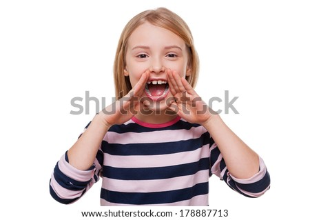 Happy little girl. Cheerful little girl shouting and holding hands near mouth while standing isolated on white - stock photo