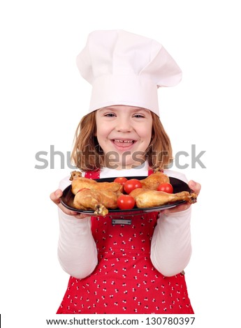 happy little girl cook hold dish with chicken drumstick - stock photo