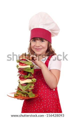 happy little girl cook hold tall sandwich - stock photo