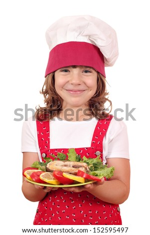 happy little girl cook holding dish with salmon seafood - stock photo