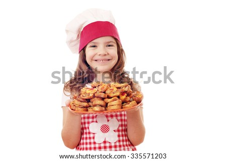 happy little girl cook with bruschetta on plate - stock photo