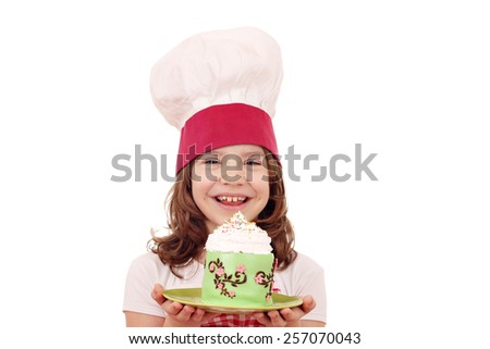 happy little girl cook with cupcake - stock photo