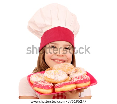 happy little girl cook with donuts fast food - stock photo