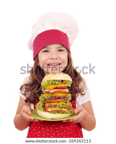 happy little girl cook with hamburger - stock photo