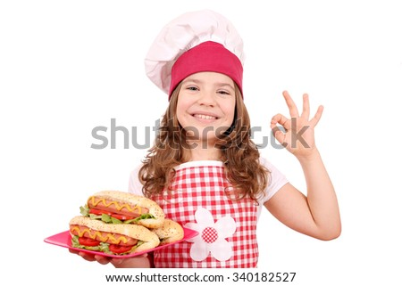 happy little girl cook with hot dogs and ok hand sign - stock photo