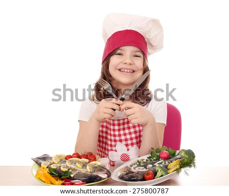 happy little girl cook with prepared trout ready for lunch - stock photo